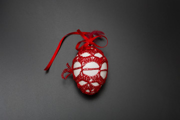 An easter egg painted and with red dress