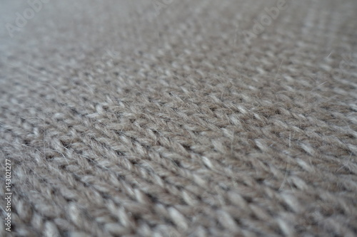 Close Up Of Grey Handmade Plain Knit Stitch Fabric Stock Photo And