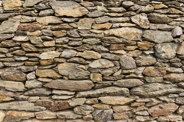 Dry masonry rock wall of natural stones