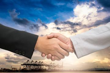 Businessman handshake for agreement of logistics partners.
