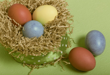 Easter symbols - colored eggs on light background. Toned