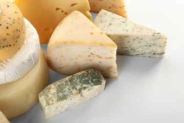 Set of various cheeses on white background, closeup