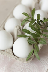 Easter eggs on pale background