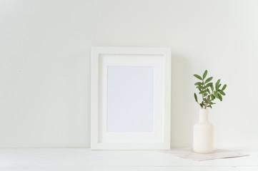 White frame mockup with vase