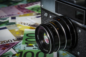 Old Soviet camera on a pile of euros