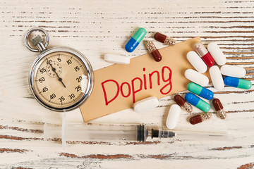 Stopwatch, syringe and pills. Fight against doping.