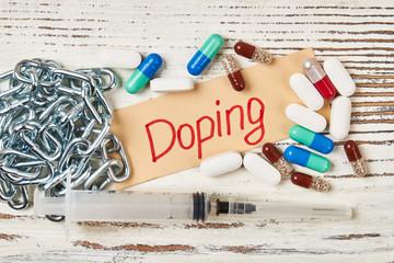 Pills, chain and syringe. Drug free sport.