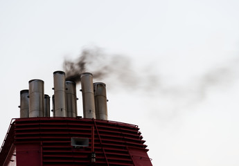 smoke from the ship stacks