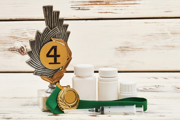 Medals and drugs on wood. Conference on doping in sport.