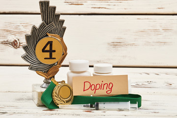 Awards, container and syringe. Doping sport concept.