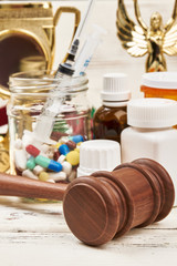 Medicines and juge's hammer. Verdict for doping in sport.