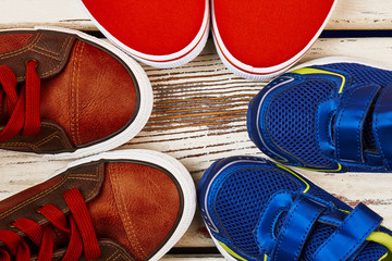 Sport shoes on wooden background. Health benefits of running.