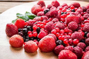 Frozen mixed berries as background.