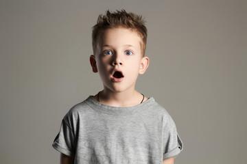 funny kid.surprised little boy.