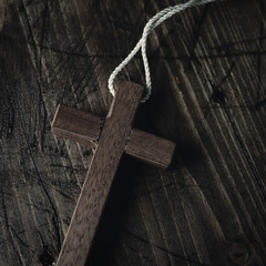 wooden cross with a cord
