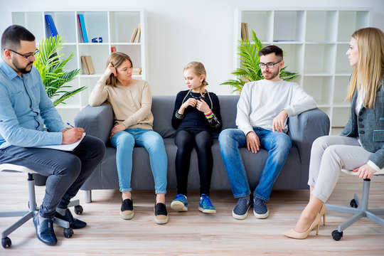 Teen daughter in family therapy