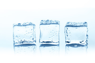 Transparent ice cubes with reflection isolated on white.