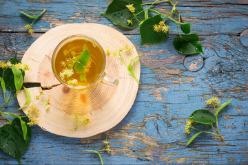 Cup with linden tea and flowers. concept of treatment cold and flu