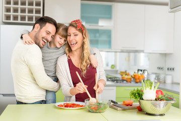 Young family preparing lunch from fresh veggies