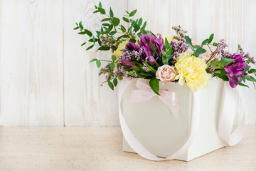 fresh flowers in box on a wooden background. Copyspace