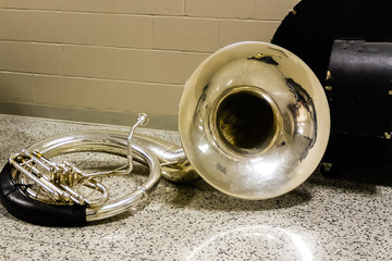 sousaphone resting before the start of marching band rehearsal