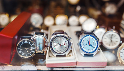 Men wrist watches in a showcase of a luxury store