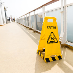 Wet floor sign on deck of cruise ship