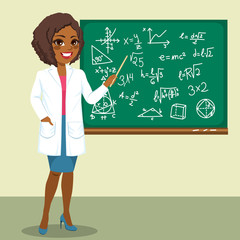 Beautiful young African American rocket scientist woman pointing mathematics formula on blackboard