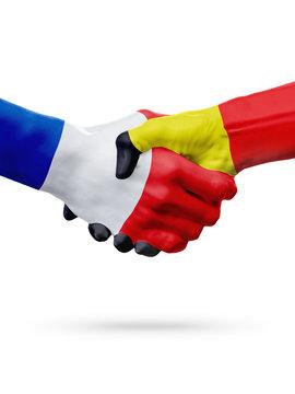 Flags France, Belgium countries, partnership friendship handshake concept.