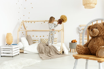 Girl in modern bedroom