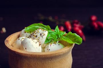 Fresh Mozzarella on wooden background