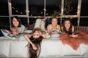 Outgoing women having fun before sleeping