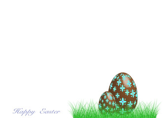 Happy Easter. Decorated chocolate egg in the green grass