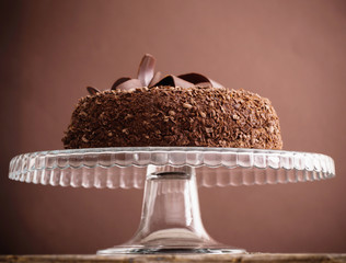 Chocolate cake on old wooden table