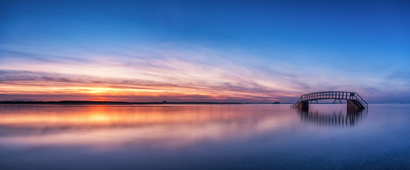 Panorama sunset of Belhaven Bridge (The Bridge to Nowhere) at high tide, Belhaven, Dunbar, East Lothian, Scotland, UK. (Bass Rock and North Berwick Law in the distance) Wall mural