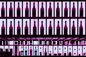 Various alcohol bottles in a barm toned image
