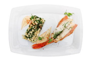 Red snapper fillet and fried celery isolated on white