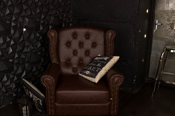 Brown leather armchair in the interior.