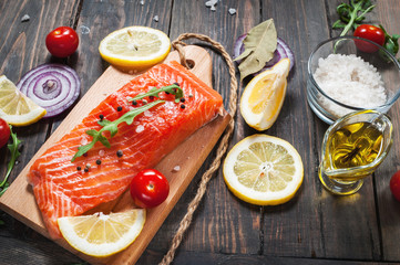 Delicious portion of fresh salmon fillet with aromatic herbs, spices and vegetables - healthy food