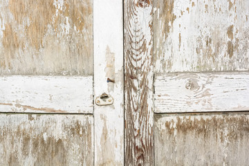 Close up of old wooden door with cracked paint