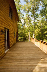 Exterior of a Log House with a Wooden Deck