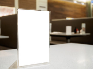 Mock up menu frame on table in the cafe restaurant