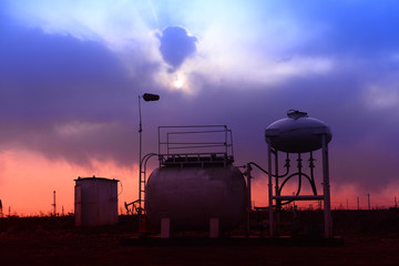 The oil tank, under the background of the setting sun