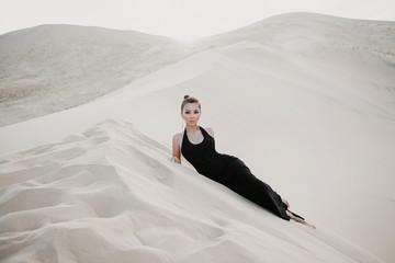 Young beautiful asian model is posing in desert