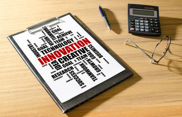 Innovation word cloud concept on a desk