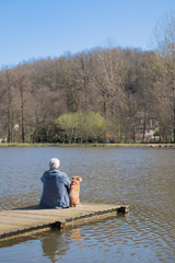 Man with dog on landing stage