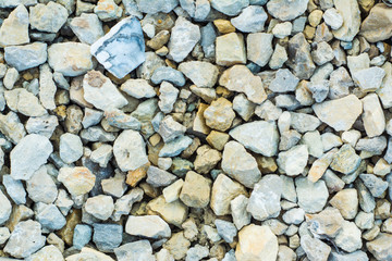 Background of many small stones of different colors, gravel or crushed stone close-up texture