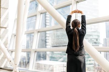 Stretching businesswoman