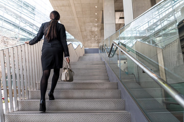 business woman going up the stairs