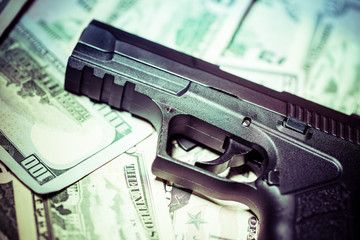 handgun close up setting on American cash
